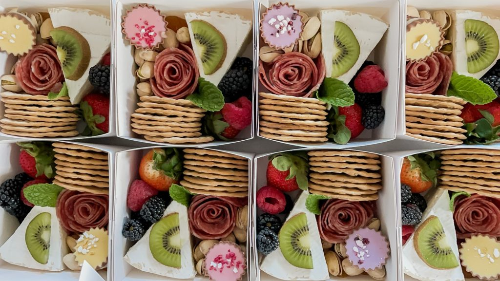 Mini charcuterie boxes with meats cheeses and fruits